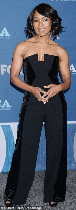 Stunners: Angela Bassett, 59, flashed cleavage in a strapless black jumpsuit while Connie Britton, 50, showed off her legs in a shiny black mini dress at a Fox TV party in LA Thursday