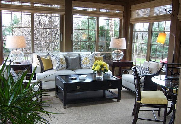Cozy sunroom design with couch and coffee table