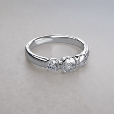 Half Bezel Set 1/2 ctw Three Stone Diamond Ring in Platinum
