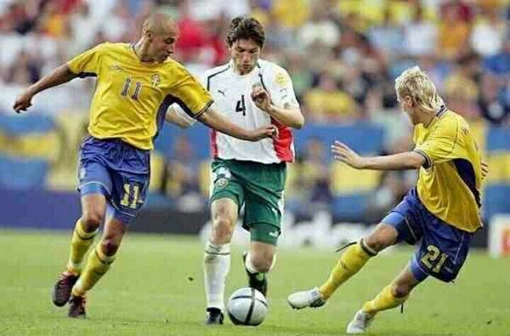 Sweden 5 Bulgaria 0 in 2004 in Lisbon. Ivaylo Petko tries to run between Henrik Larsson and Christian Wilhelmsson in Group C at Euro 2004.
