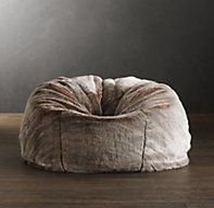 Restoration Hardware's Grand Luxe Faux Fur Bean Bag Chair - Lynx:A wrap of sumptuous luxury faux fur updates this relaxed 1970s icon. Comfortably oversized yet still portable, it provides sink-in comfort with all the indulgent softness of genuine fur.