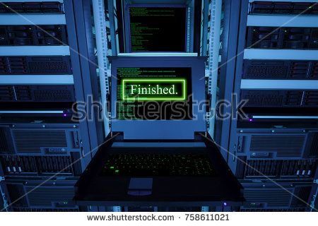 """""""Finished"""" text and blur programming code on display of computer for management server in data server room"""