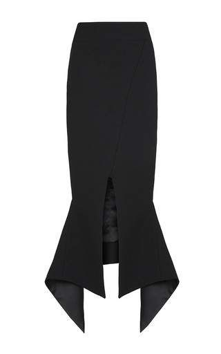 This **Maticevski** skirt features a high waist with a wraparound design at the front, a form fitting pencil skirt silhouette with a split at the front, and an asymmetric hem.