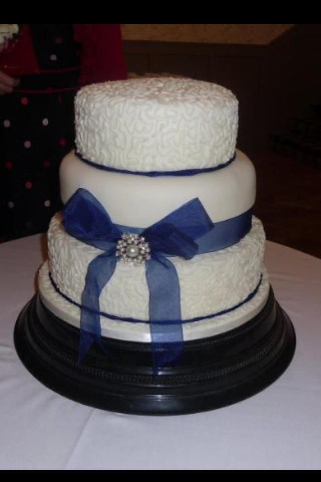 Royal Blue And White 3 Tiered Wedding Cake With Pearl Diamanté Buckle