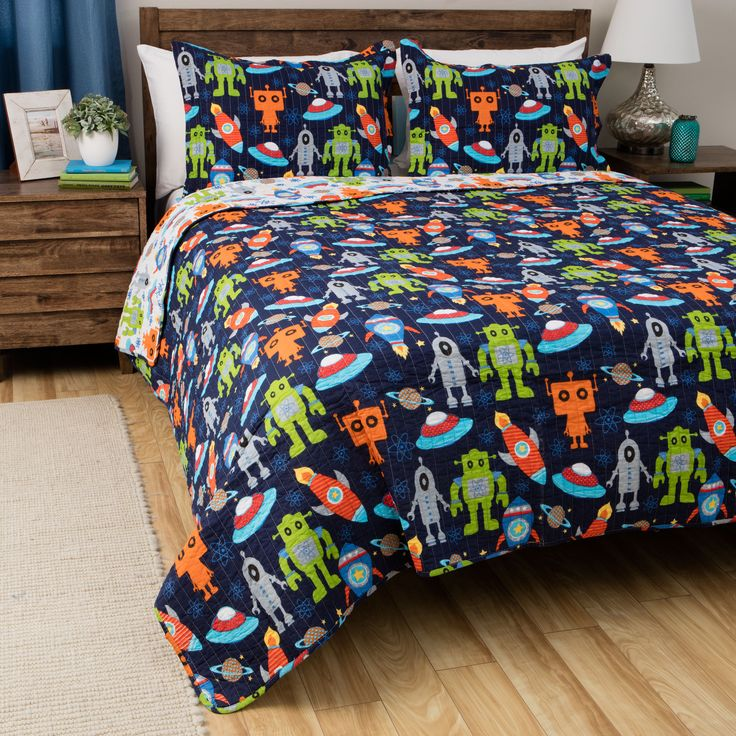 This great comforter set offers a comforter and two shams in a space motif. It is crafted with 100 percent cotton and conveniently machine washable.
