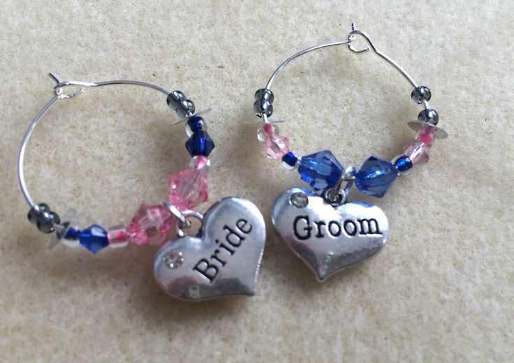 Bride and Groom wine glass charms, part of a larger set made for the wedding party. www.handmadecraftcompany.co.uk