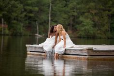 Southern Spring Yellow and Gray Lesbian Wedding | two brides kiss on a lake