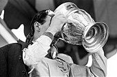 Jim Clark, British Formula One racing driver for Lotus-Climax, pictured celebrating after winning British Grand - Stock Photo