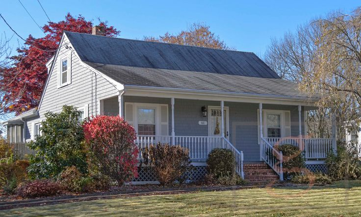 A Classic 39 Cape Cod 39 House With A Farmer 39 S Porch Sits