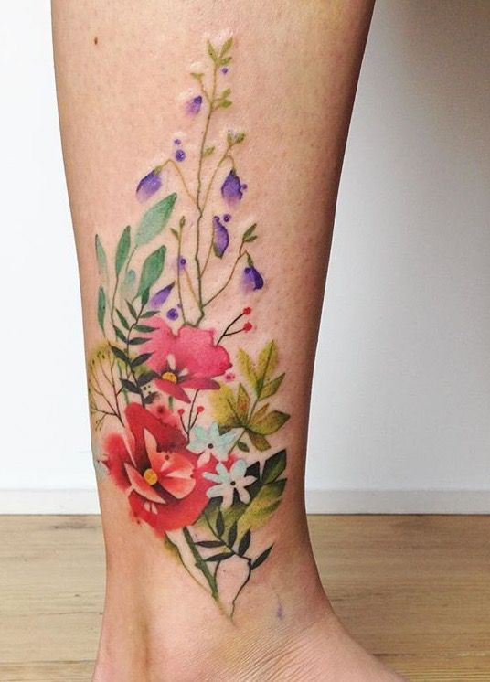 Aga Yadou watercolor flower tattoo