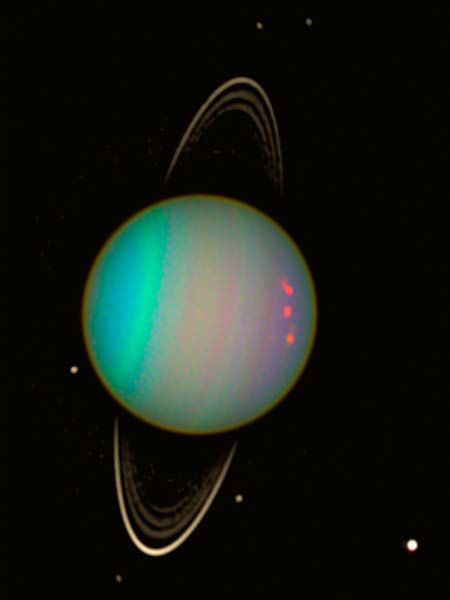 Uranus tilt essentially has the planet orbiting the sun on its side, the axis of its spin is nearly pointing at the sun. - Credit: NASA and Erich Karkoschka, U. of Arizona