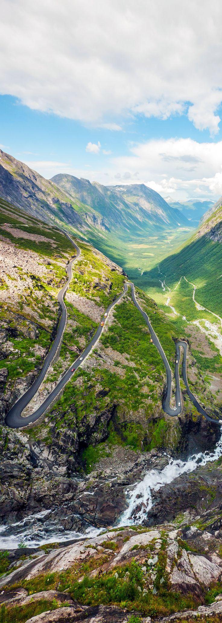 Trollstigen serpentine mountain road and Stigfossen waterfall. Part of Norwegian National Road. NORWAY