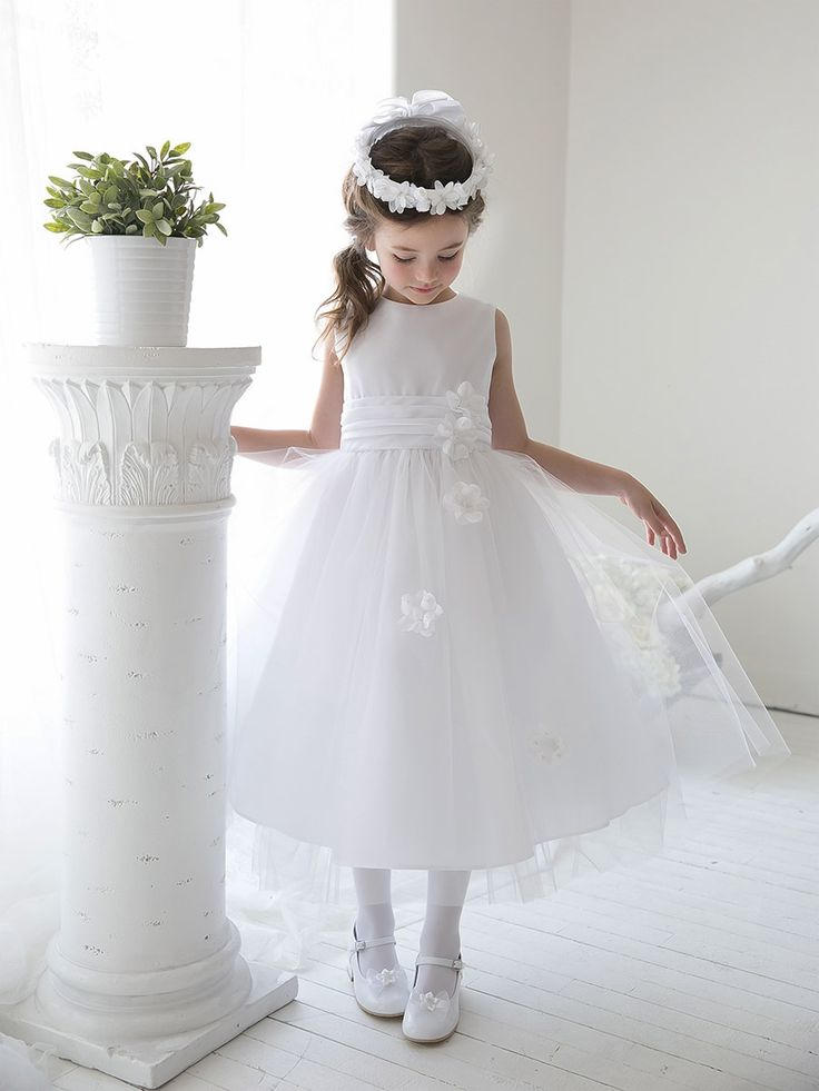 """""""There is only one thing wrong. Celeste's dress hasn't arrived. Every day Celeste rushes to the door when she hears the postman and every day she is disappointed. The postman doesn't have a parcel for her containing her beautiful white dress. Celeste starts to worry.""""-Chapter 14: The First Holy Communion, The Angels of Abbey Creek"""