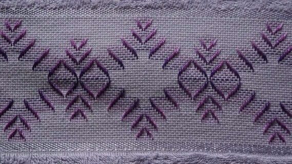 looks like Huck Weaving / Swedish Embroidery done on a pre-made towel with Aida insertion