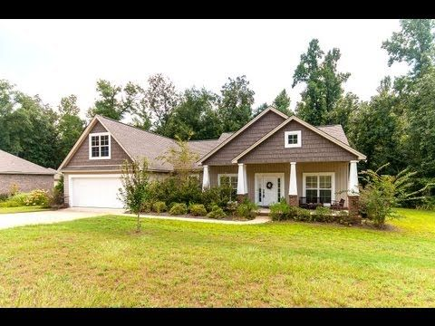 Craftsman style 3BR/2BA home w/bonus. Kitchen has granite counters, plenty of cabinets, work island & upscale stainless frig. Breakfast area w/bay windows. Great room w/corner gas log fireplace & wood floors. Master bath w/garden tub+sep. shower. Master walk-in closet has built in drawers & organizers. Private backyard & wooded lot w/stream. Betty Cannon 334-224-8311 w/RE/MAX Properties. Photos & tour by Sherry Watkins…I Shoot Houses…http://www.Go2REassistant.com/VirtualTours.htm