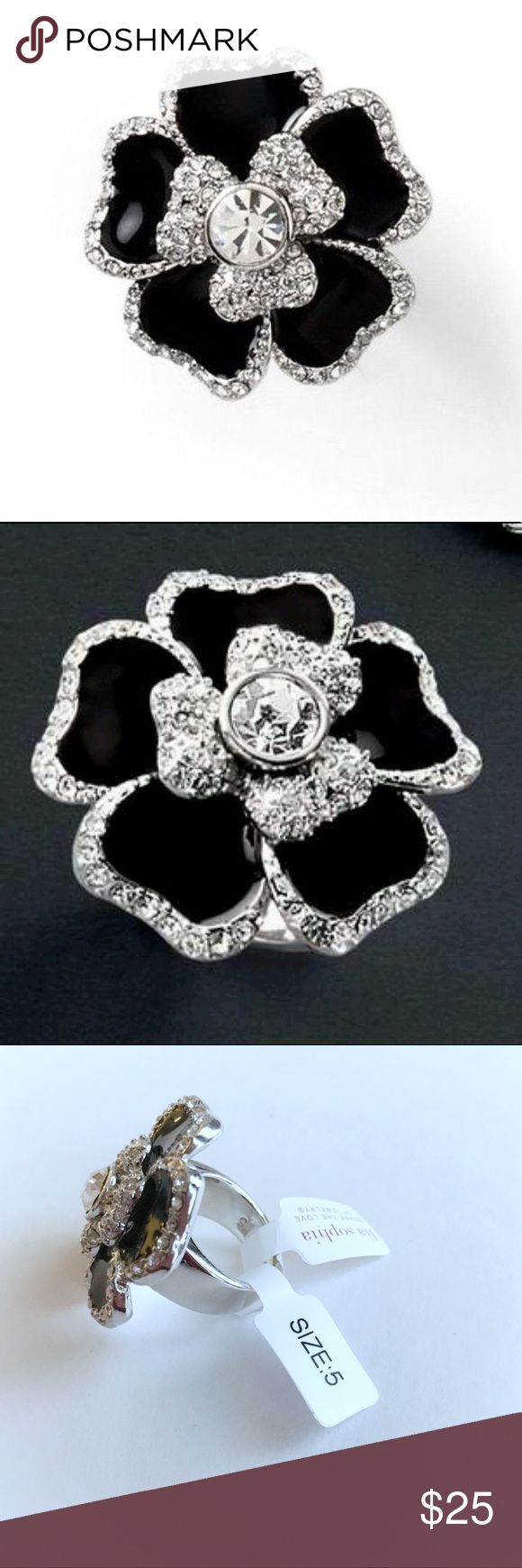NEW Lia Sophia Black Dahlia Blooming Ring, Size 5 Brand new with tags. Size 5.  This blooming flower of a ring is simply exquisite with it's shiny, onyx black enamel petals - each one trimmed with tiny, sparkly crystals. The center stone is beautifully cut and faceted for serious brilliance. Shiny silver-tone band. Lia Sophia Jewelry Rings