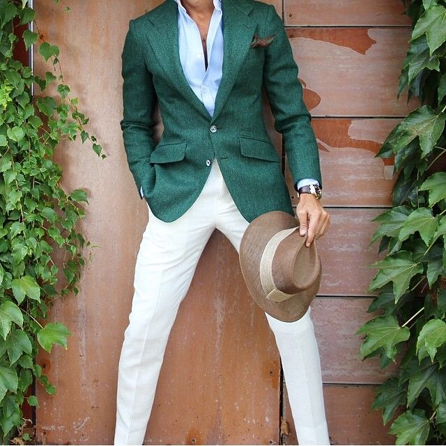 What a unique look! I really like the green blazer, and white pants are great in the summer.