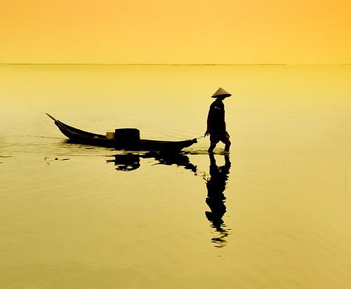 Fisherman. Conical hat. Boat. Hue, Vietnam