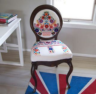chair upholstered with mexican dress. Loving this!!!!