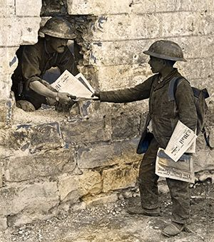French newsboy selling the Daily Mail to a Canadian soldier. Associated Newspapers