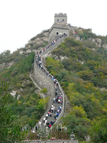 Climbing up the Great Wall of China is an interesting travel experience. The stairs are steeper, deeper and more rough than photos indicate. And we did mention that there are no stair rails. Still, it's a worthy China travel experience  for your bucket list.