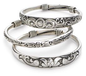 Not sterling silver, but very pretty nonetheless, I really like the koi with lotus one on the bottom!