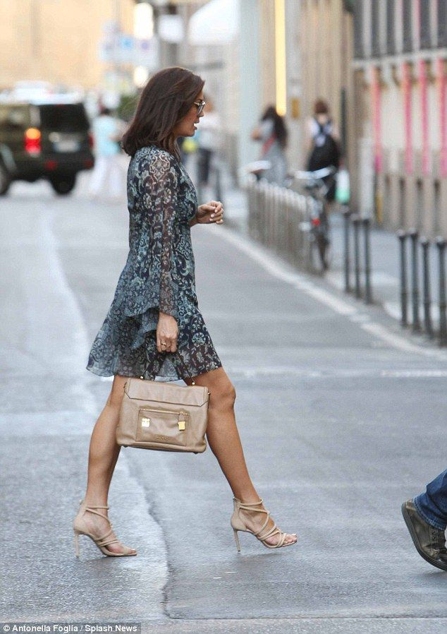 Leggy lady: The 40-year-old showed off her enviable legs in a flirty little dress...