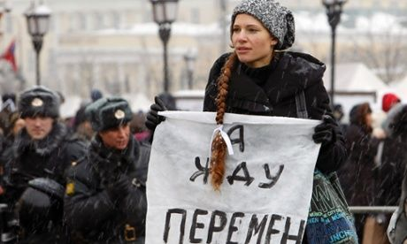 """Memorial, a human rights organization founded by Andrei Sakharov, is to be dismantled and declared a foreign agent by Putin's government.  A protester holds a sign reading """"I am waiting for changes"""" at an opposition rally in 2012."""