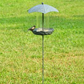 """Artfully crafted of aluminum with an umbrella silhouette, this artful bird feeder offers a welcome retreat for your feathered friends.   Product: Bird feederConstruction Material: Aluminum, iron and glassColor: GreenDimensions: 49"""" H x 16.5"""" W x 14"""" D"""