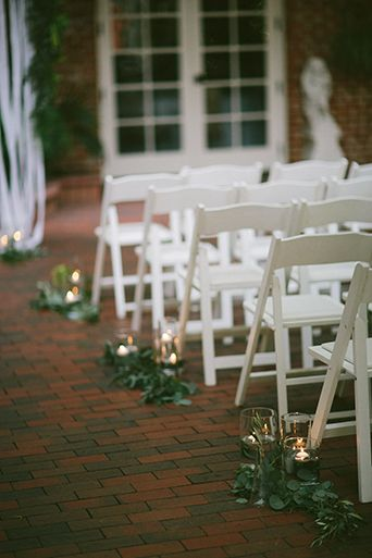 Modern Vintage styled San Diego wedding at the Horton Grand hotel ceremony red brick walk way with white chairs and white floral accents along aisleway with white candles standing in the aisle next to the chairs