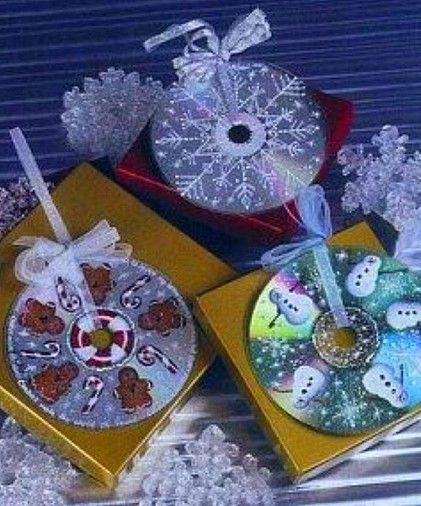 Christmas ornaments made from CDs and puffy paint! So cute!!