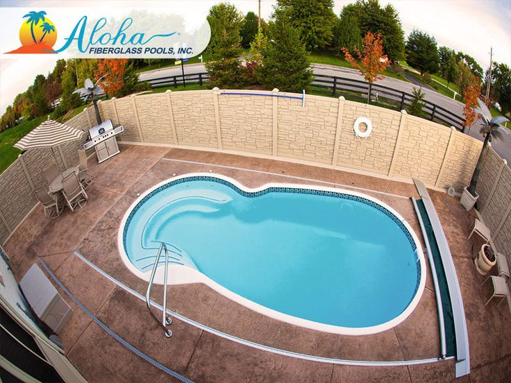 """The Neptune features elegant side entry steps with a beautifully curved seat that wraps around the end of the pool. This unique shape is both elegant and modern, and provides many design opportunities. The Neptune is a free form fiberglass pool that is 11'x23' and goes to 5'6"""" in depth.  For more information about Aloha Fiberglass Pools or to find a local pool builder in your area that can assist you, visit www.AlohaFiberglassPools.com> or call (800) 786-2318."""