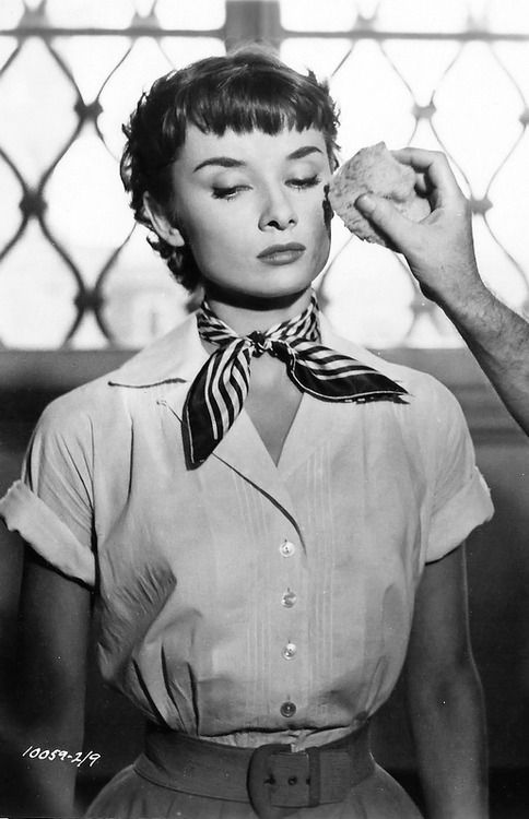 Director William Wyler touches up Audrey Hepburn's makeup on the set of Roman Holiday, 1953.