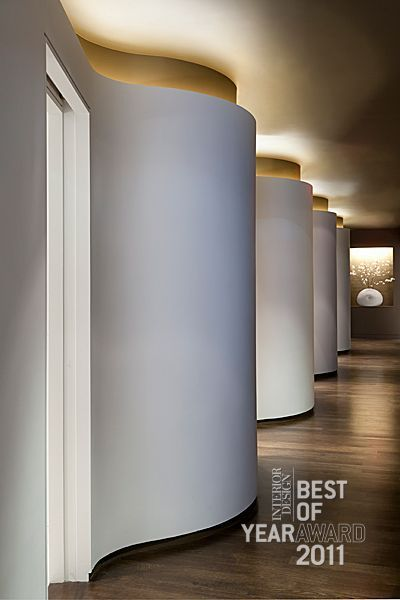 white curved wall, cove light, contemporary design. I foresee only one 'bulge' before straightening out into useable, hang-able wall space in our case.: