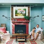 canvas art frame on a rail to hide the television (Southern Living)