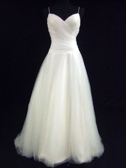 Simple Wedding Dress. Could add a ribbon (that goes with the colour scheme?) at the waist.