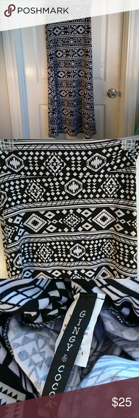 Black & White Tribal Maxi Skirt NWOT This is a Maxi Skirt with a tribal print in black and white. It is new without tags and has no rips, loose material or stains. It is in excellent condition. It is a Polyester and Spandex blend material. Gingy & Cocoa Skirts Maxi