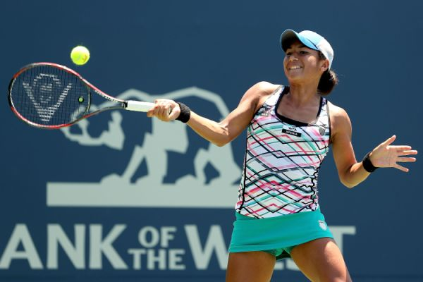 Heather Watson of Great Britain returns a shot to Yanina Wickmayer of Belgium during the Bank of the West Classic at Stanford University Taube Family Tennis Stadium on July 11, 2012 in Stanford, California.