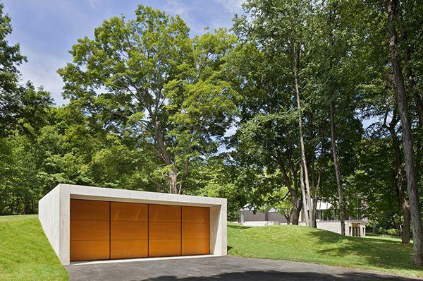 modern garage 1/2 buried into hill side.