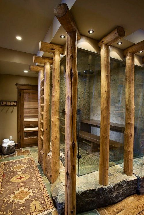 Log Home Bathroom | Shower with Log Poles and Glass and Stone Floor | with A Sauna