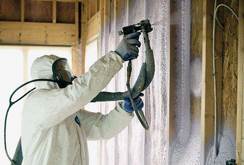 Spray Foam Insulation being sprayed into a cavity