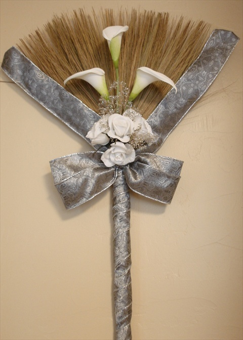 Jumping the broom. Follow us @SIGNATUREBRIDE on Twitter and on FACEBOOK @ SIGNATURE BRIDE MAGAZINE