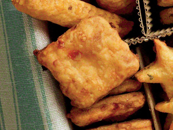 Pimiento Cheese Squares - Take the flavors of the South's favorite spread and make into savory bites of Pimiento Cheese Squares--perfect for parties or gifts. http://www.myrecipes.com/recipe/pimiento-cheese-squares