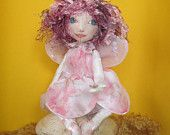 """Fairy """"Petal"""" This beautiful fairy in her pretty pink petal shaped dress and organza wings decorated with sequins and beads. Looking at the tiny, butterfly that has landed on her hand.  Designed and made lovingly by me.  Sits aprox 16cm. SOLD"""