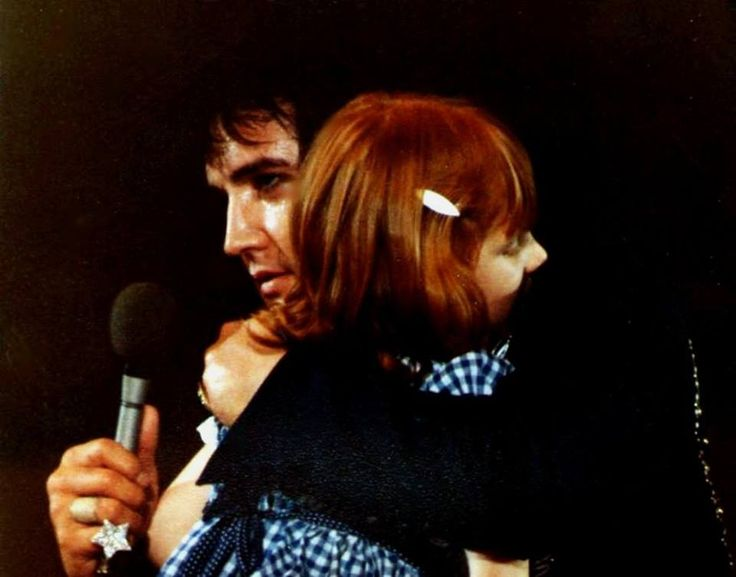 JULY 20, 1975 - Elvis saw a little girl standing on the far left of the stage. He walked over and knelt in front of her. Realizing she was blind, he held her hands and spoke to her for a few minutes. He kissed his scarf and touched both eyes with it then held the scarf to the child's face. According to K. Westmoreland, he had Dr.Nick  put them in touch with a pediatric specialist who said she needed corrective surgery which Elvis paid for in full! Such a HUGE heart!