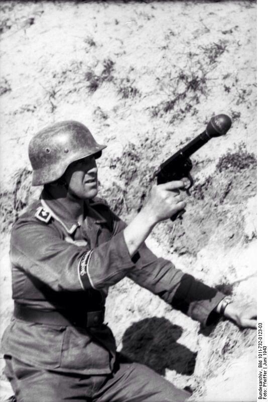 "Oberfeldwebel from Division ""Großdeutschland"" with a grenade launcher pistol (Kampfpistole and Wurfkörper 361 LP). Russia June 1943"