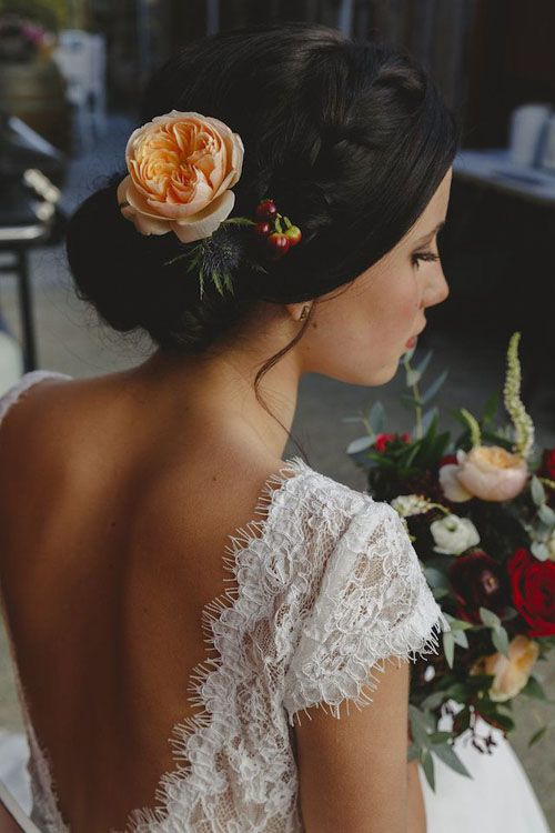 Think lace and floral when it comes to your wedding dress and hair