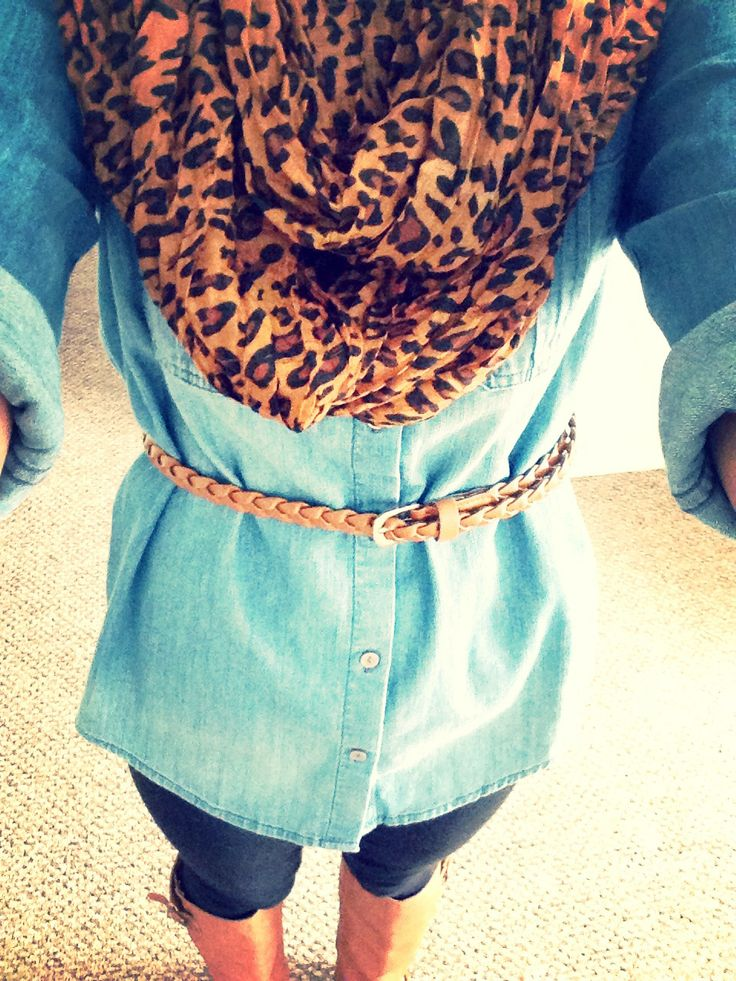 Leopard scarf, denim shirt with a belt, tan boots, and black leggings. Combination makes for a good outfit.