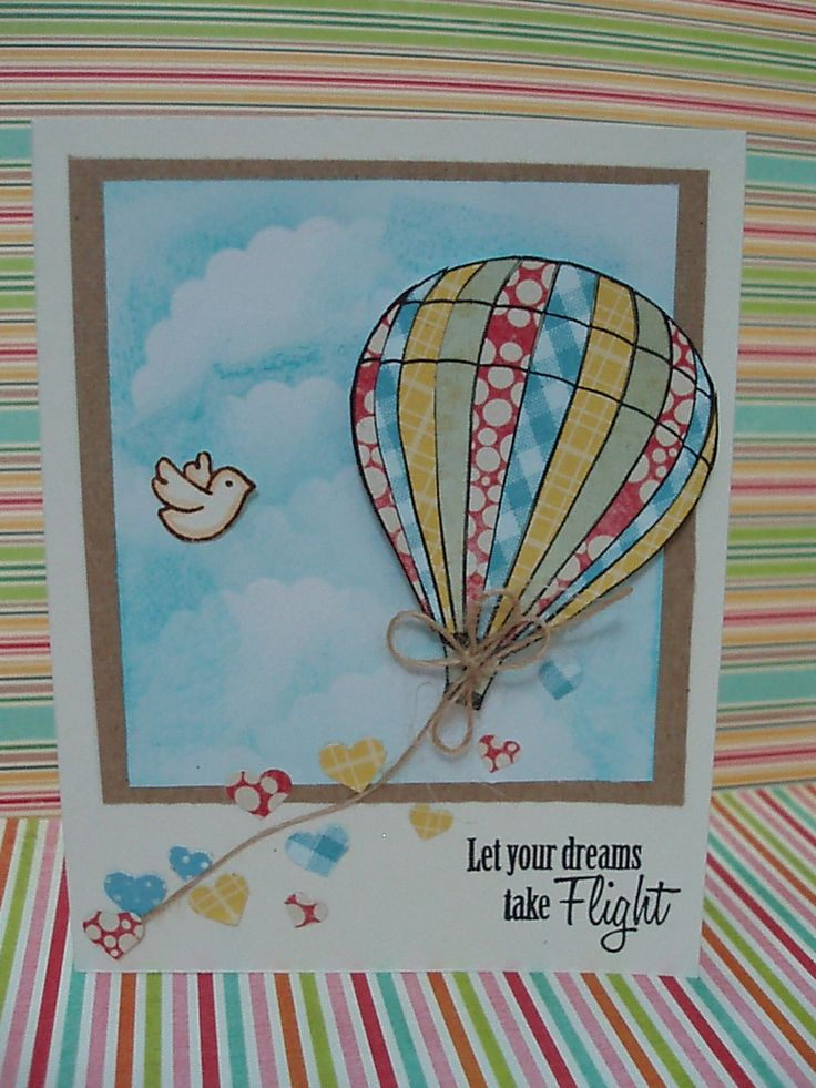 I love the hot air balloon sticking out of the frame, gives the card depth :)