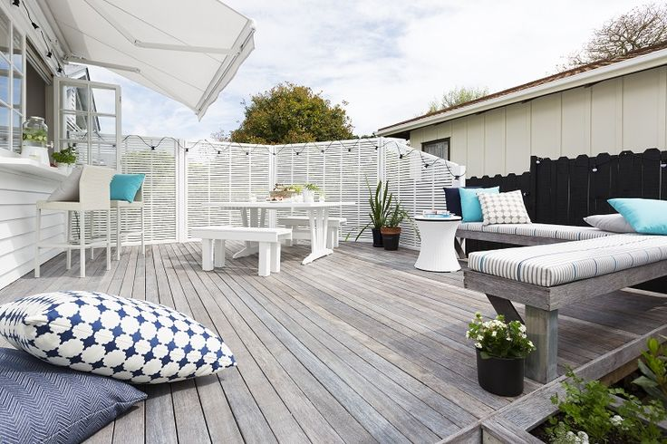 The final reveal! A light, fresh Scandinavian look was achieved by using Cabot's Deck & Exterior stain in Silver Beech colour on the decking timber. To finish the look we painted both the trellis fences and the house a fresh white, Dulux Mt Aspiring Quarter and then added a fresh mix of custom made cushions and squabs in UV resistant fabrics designed to go outside. Decorating products are available in New Zealand through Guthrie Bowron stores.